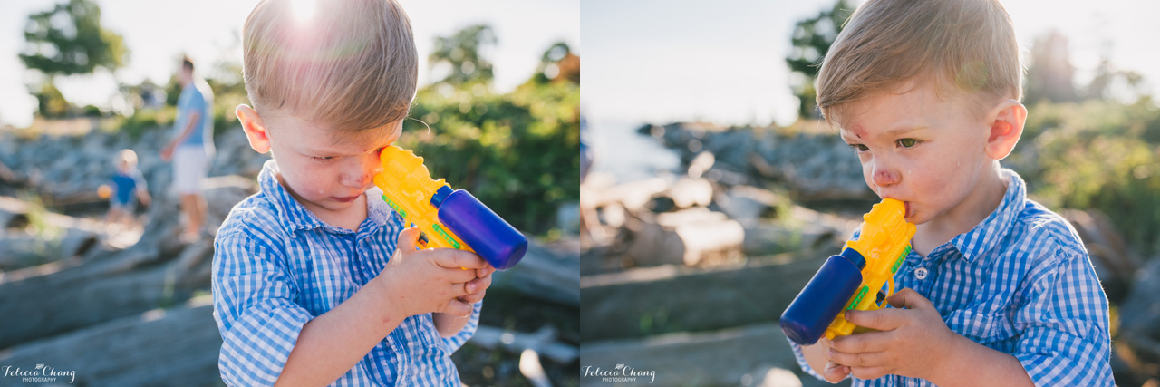boy creatively using water guns, vancouver family photographer, Felicia Chang Photography
