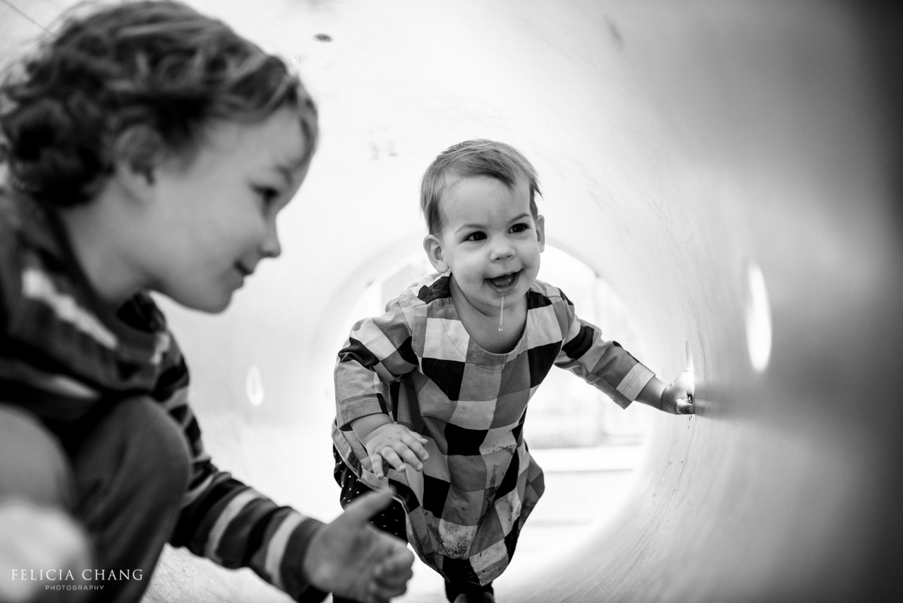 Brother and sister in the playground tunnel