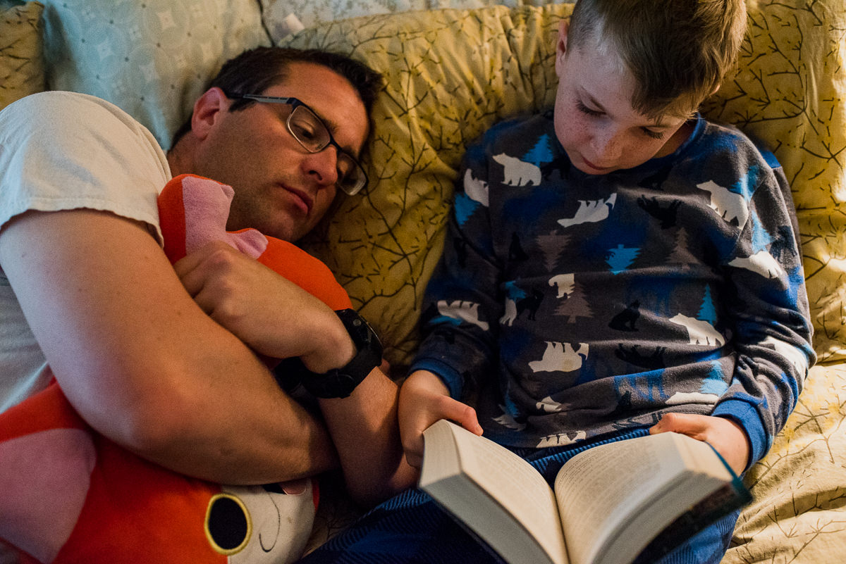 dad reading to his son at bedtime
