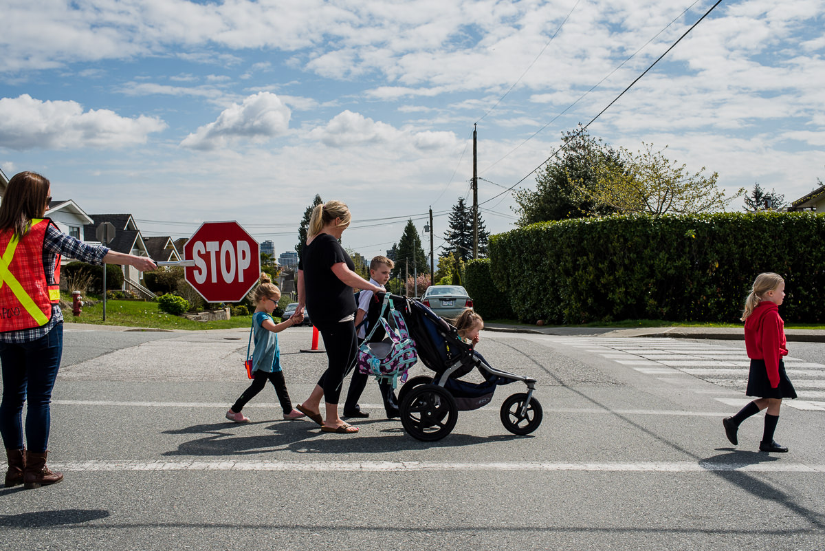 mom crossing a school crosswalk with 4 kids