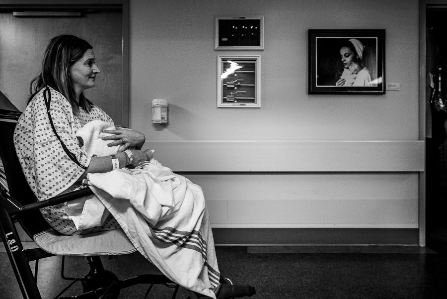 mom getting wheeled from delivery to maternity ward
