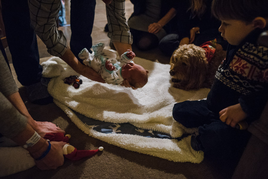 placing a newborn baby onto a blanket