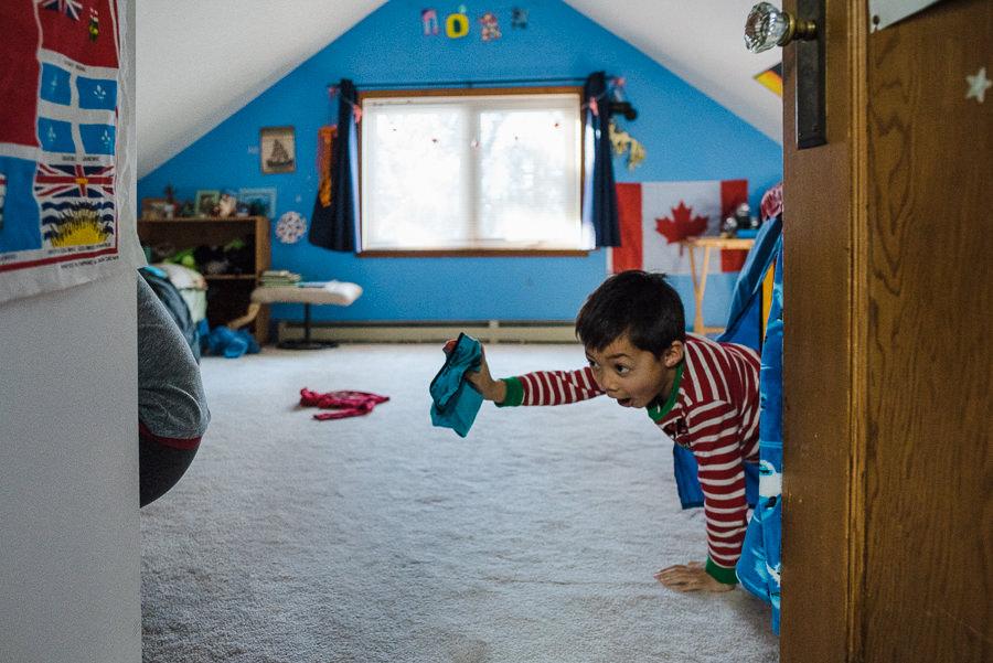boy throwing underwear in his bedroom