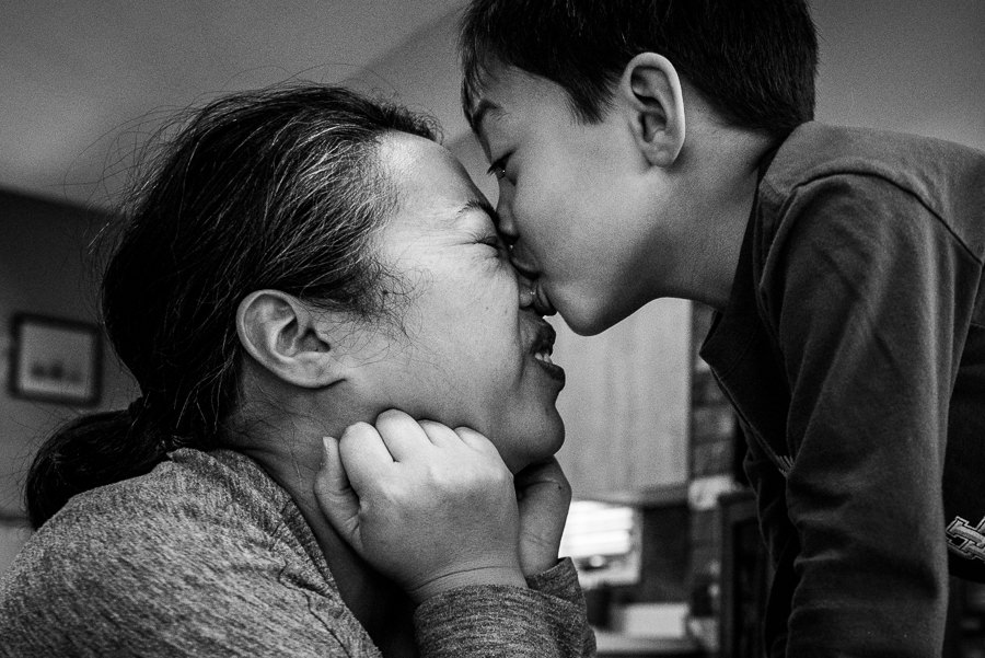 boy kissing mom on her nose