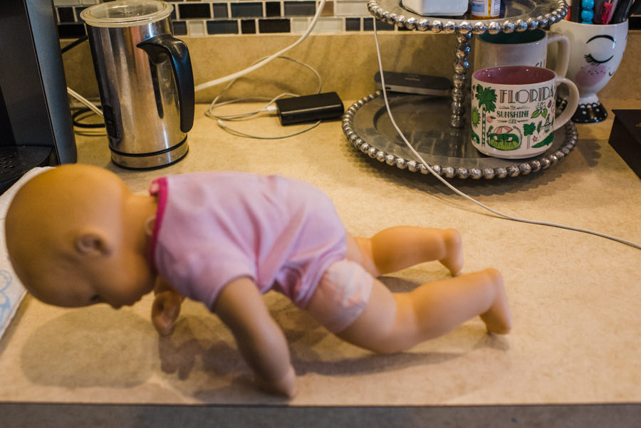 baby doll on kitchen counter