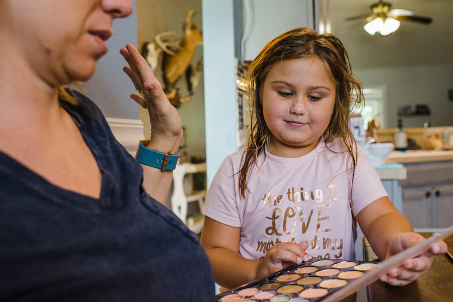 girl showing mom her makeup palette
