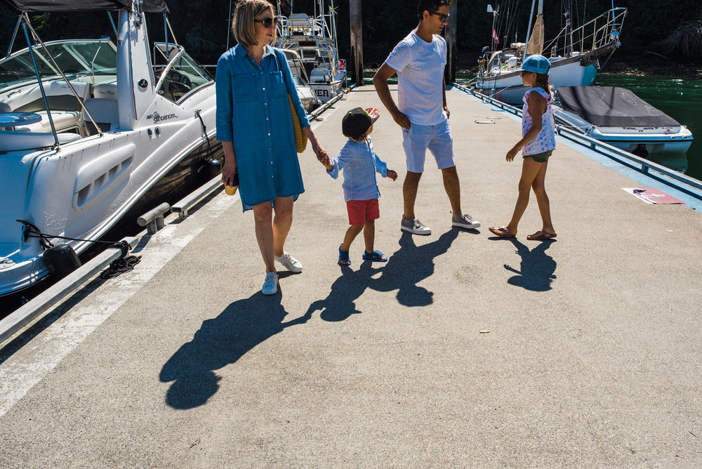 family walking together on the dock on Bowen Island