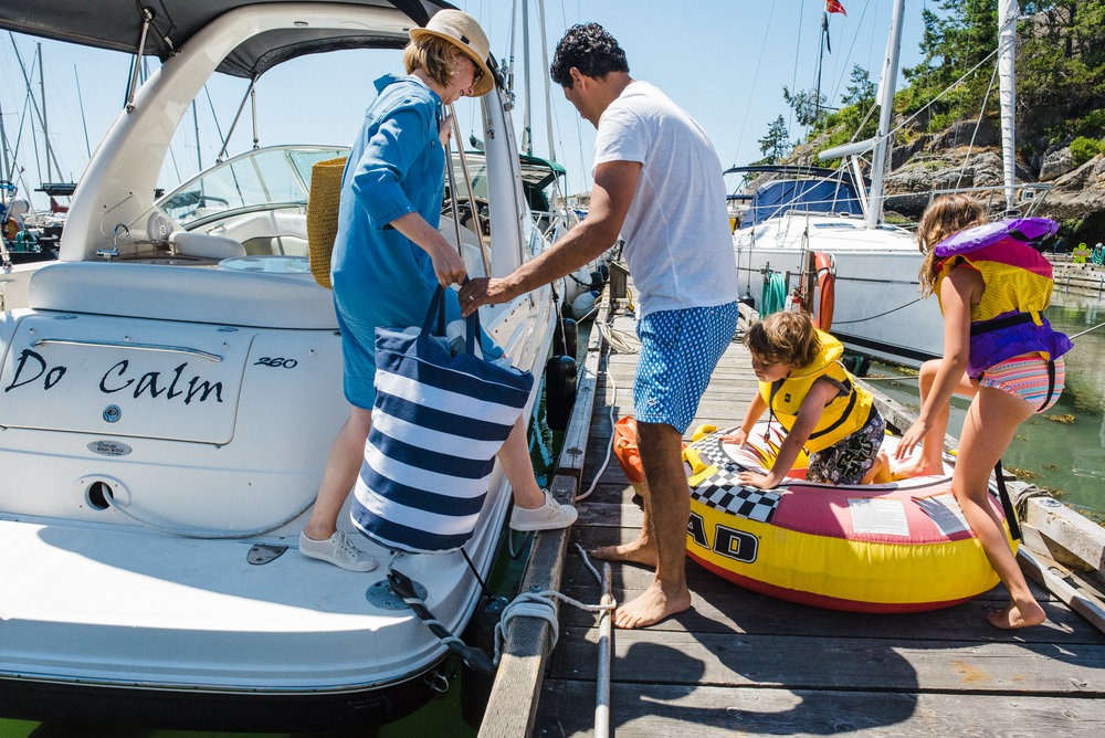 family getting of their boat while carrying swimming gear