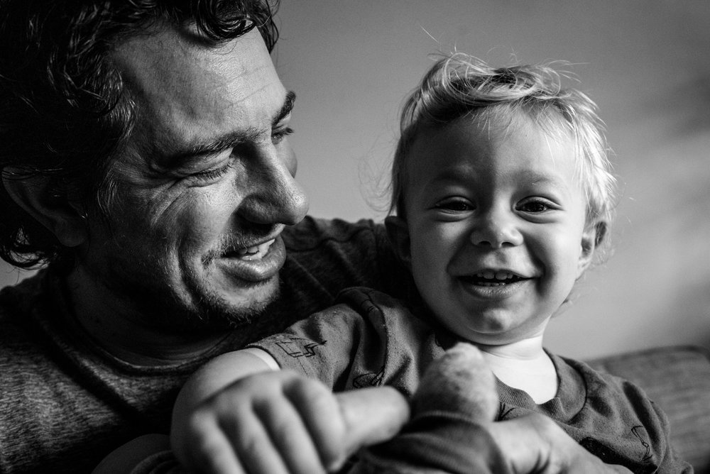 Smiling Portrait of toddler boy and his dad.