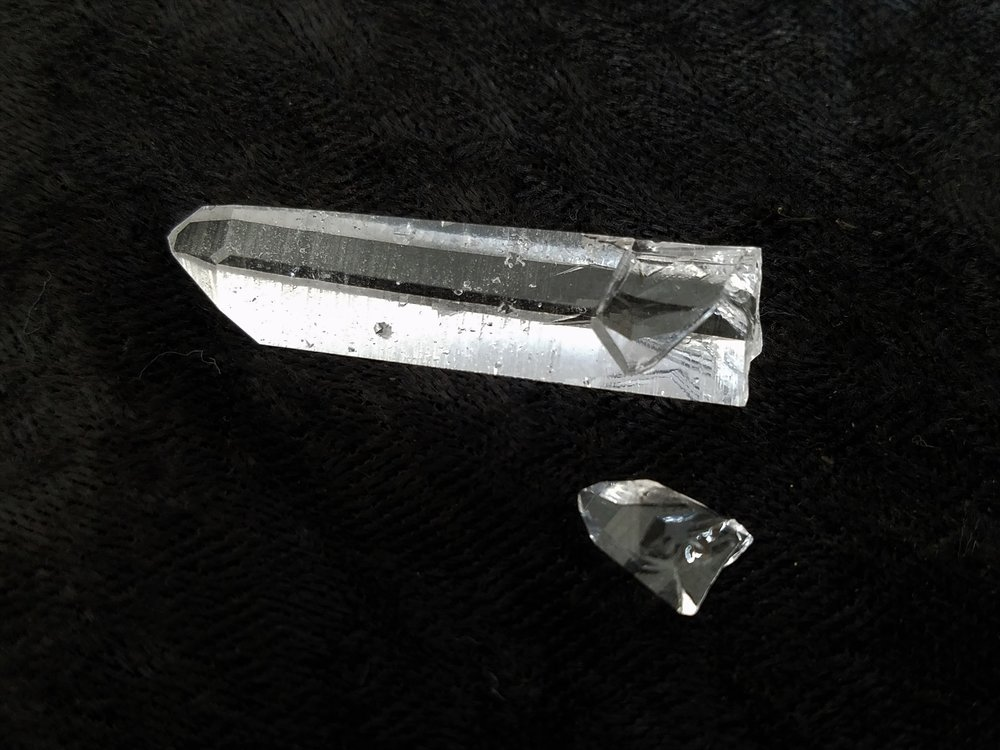Crater - When two crystals grow together, and then at some point separate, leaving behind a clear imprint of one another.