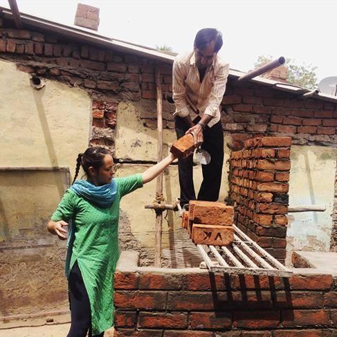03_Bholu 15_Niini passing recycled bricks to bricklayer copy.jpg