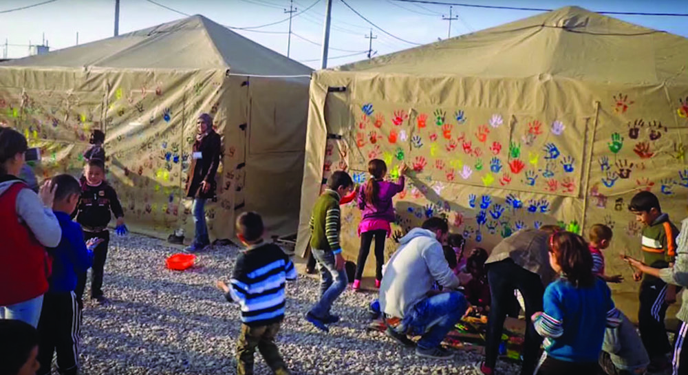 ht-tent-iraq-kids-handprints.jpg