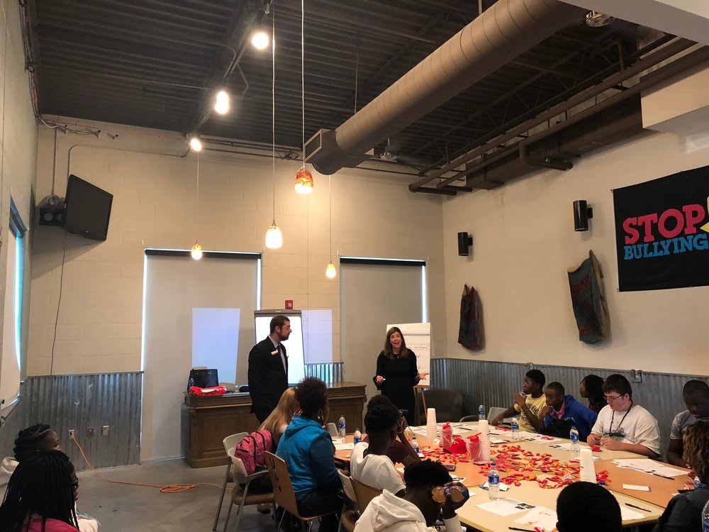 JWAGI Member Staci Bennett, a Financial Advisor for Merrill Lynch, presents during a financial literacy program at the Boys and Girls Club Teen Center