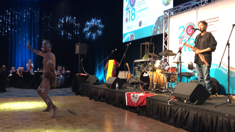 Father and son sharing traditional story, music, and dance at the Gala event