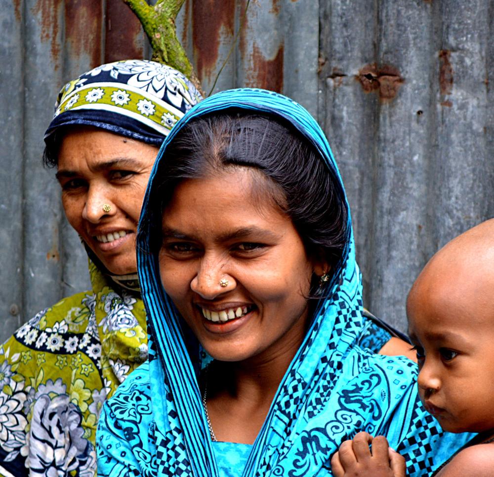 Women with a child in Bangladesh. Source: Theodore Goutas via Unsplash