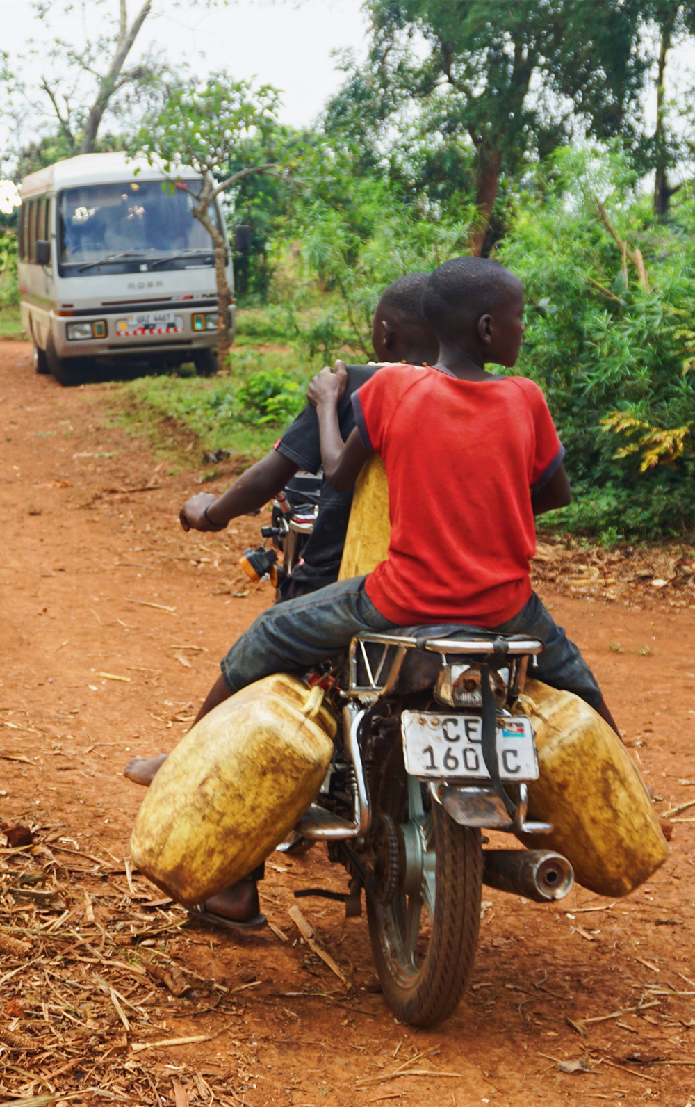 People on a motor bike in Uganda. Source: Melissa Askew via Unsplash