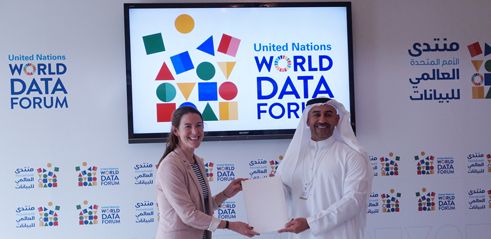 His Excellency Abdulla Lootah, Director-General of FCSA, (R) and TReNDS Director Jessica Espey (L) present the signed Memorandum of Understanding between FCSA and SDSN Association. Source: Jay Neuner for TReNDS