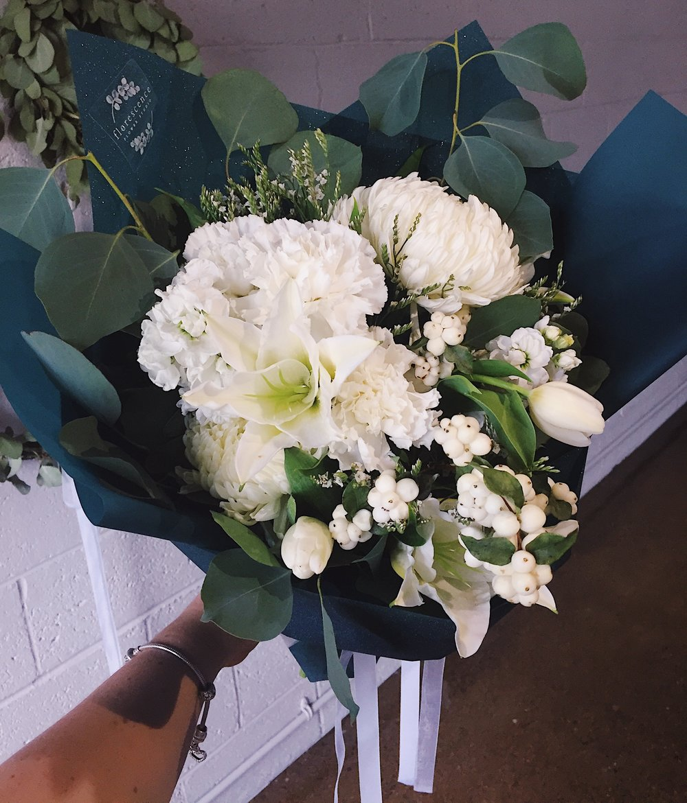White mixed bouquet in emerald sparkly wrap