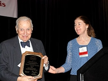 Nobel laureate Dr. Ken Arrow receives the 2009 Distinguished Achievement Award from then SRA President Dr. Alison Cullen.