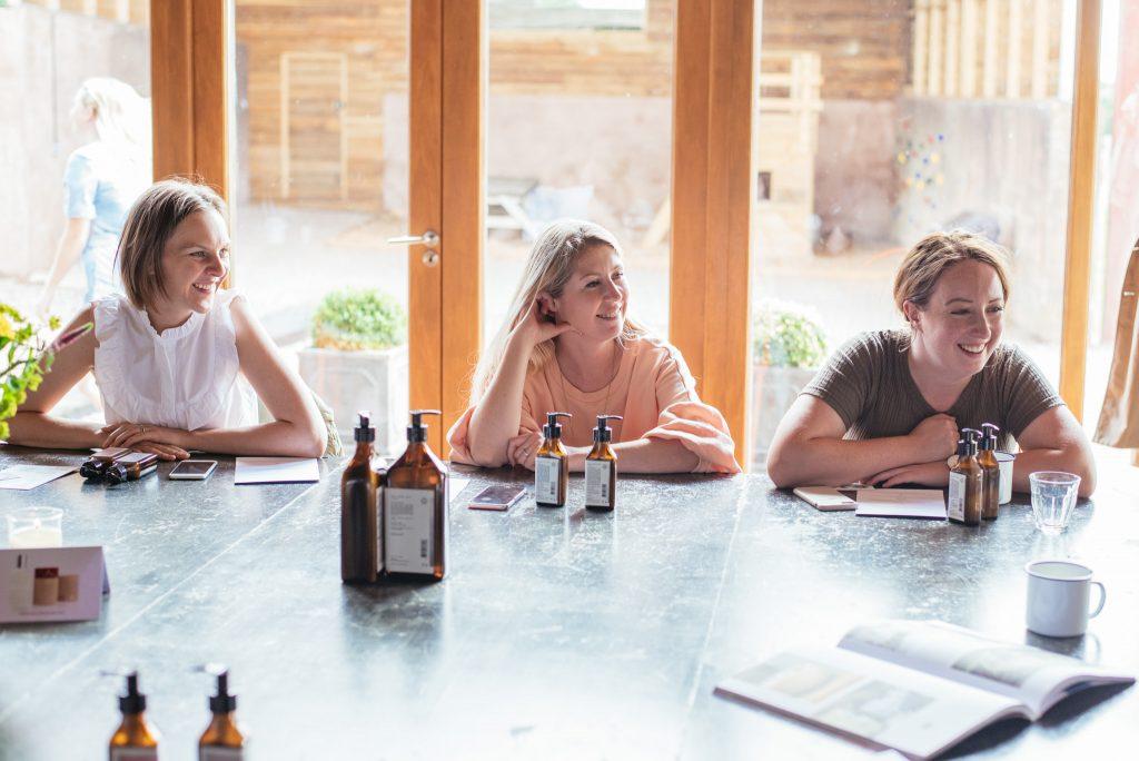 Erica, Lori and Kym listening to LA-EVA's brand story