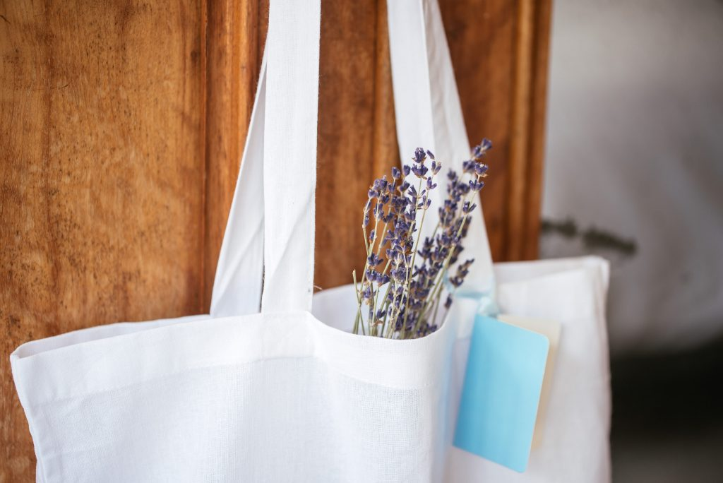 Cute goodie bag with fragrant addition by Wilderness Flowers.