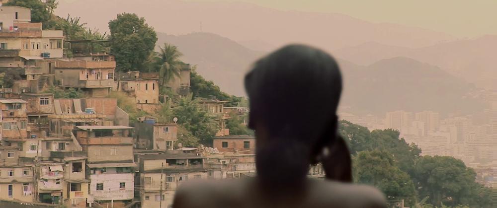 Brazilian girl on a balcony with a beautiful view of Brasilia