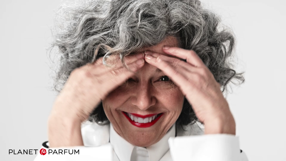 elderly lady with gray hair and white suit