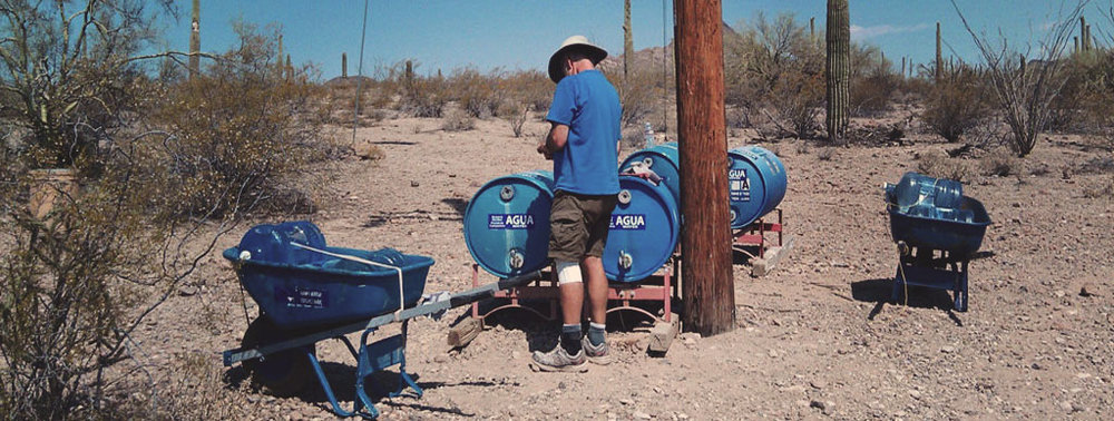 The  Humane Borders  organization refills water stations in the desert along the Mexico-U.S. border, via Wikimedia.