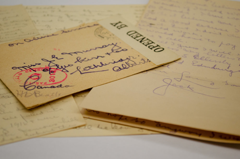 Letters and envelope that Sgt. Murray sent to his sister from France in the Galt Museum & Archives.