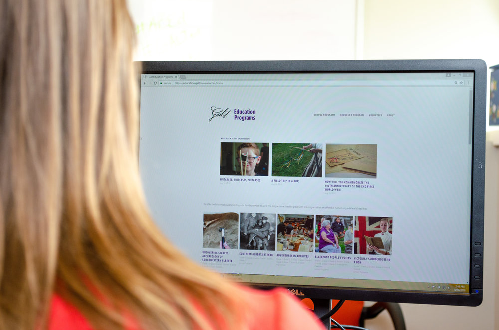 A view of the new Galt Education Website over the shoulder of Museum Educator Ashley Henrickson