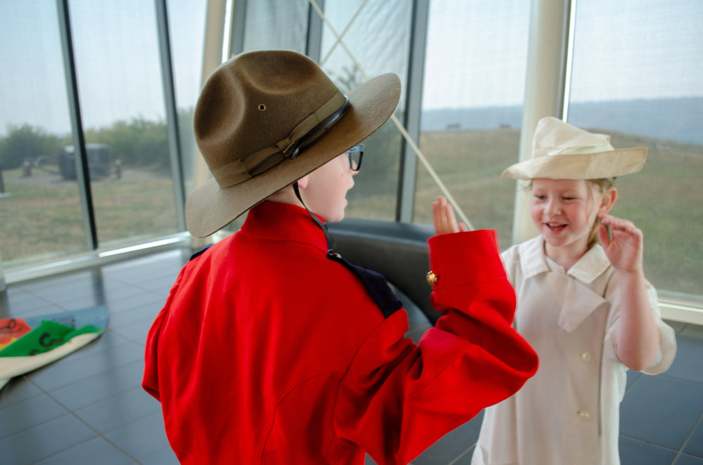 Two children dressed up as a mountie and a nurse in the Galt's Viewing Gallery.