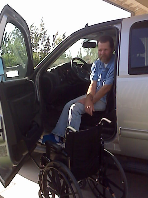 Driving his pickup