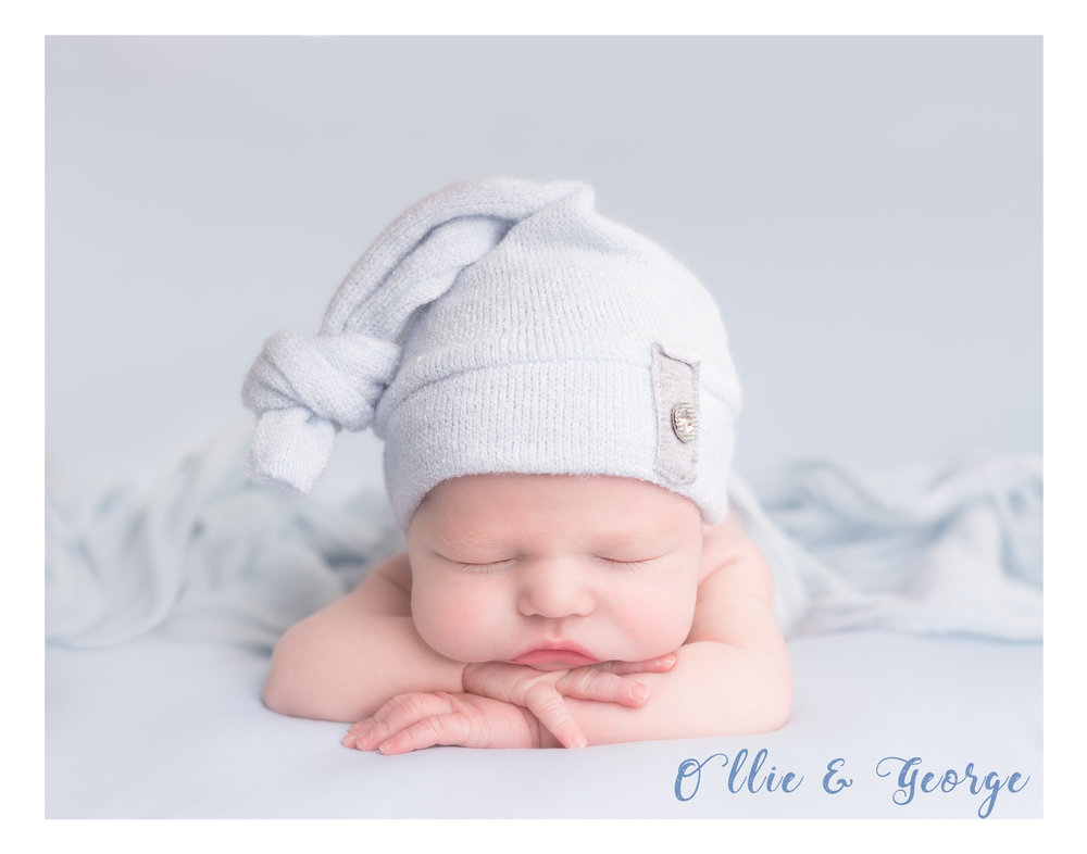 Newborn baby boy at photography shoot Preston Lancashire wearing cute hat, head on hands pose