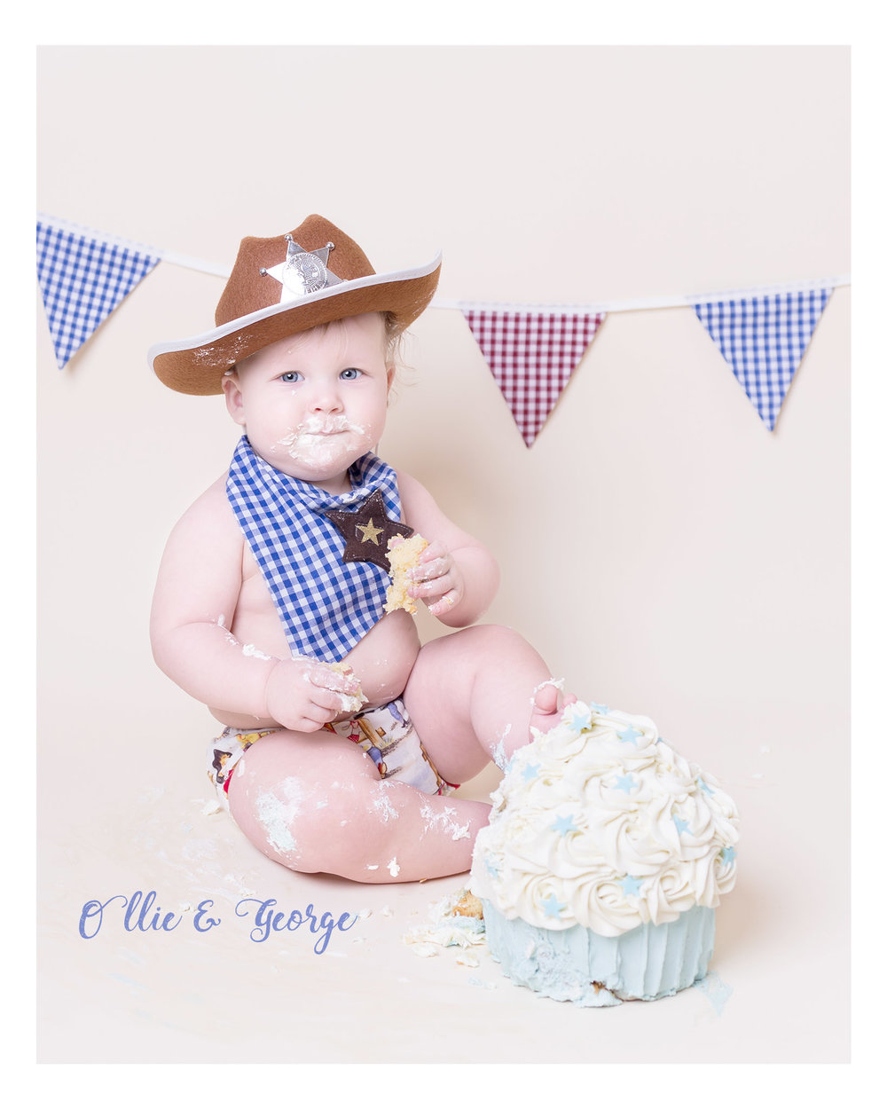Cake smash baby photo shoot at Ollie & George Photography Blackburn Lancahsire. Cowboy themed with blue cake