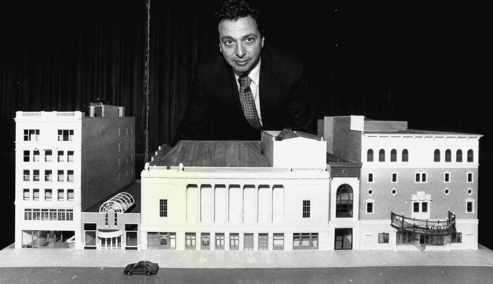 Douglas Durst stands behind a scare model of the Times Square Theatre and New Victory Theater. The Durst Organization would eventually build the first building as part of the 42nd Street Development Project, across the street at 4 Times Square. Credit: Getty Images