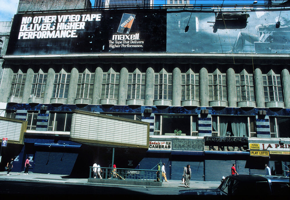 View of 42nd Street in 1992, East of the current site of the New Victory Theatre. Many of the businesses on 42nd Street had been shuttered at condemned at this stage of the project. Credit: Peter Aaron/Otto for Robert A.M. Stern Architects