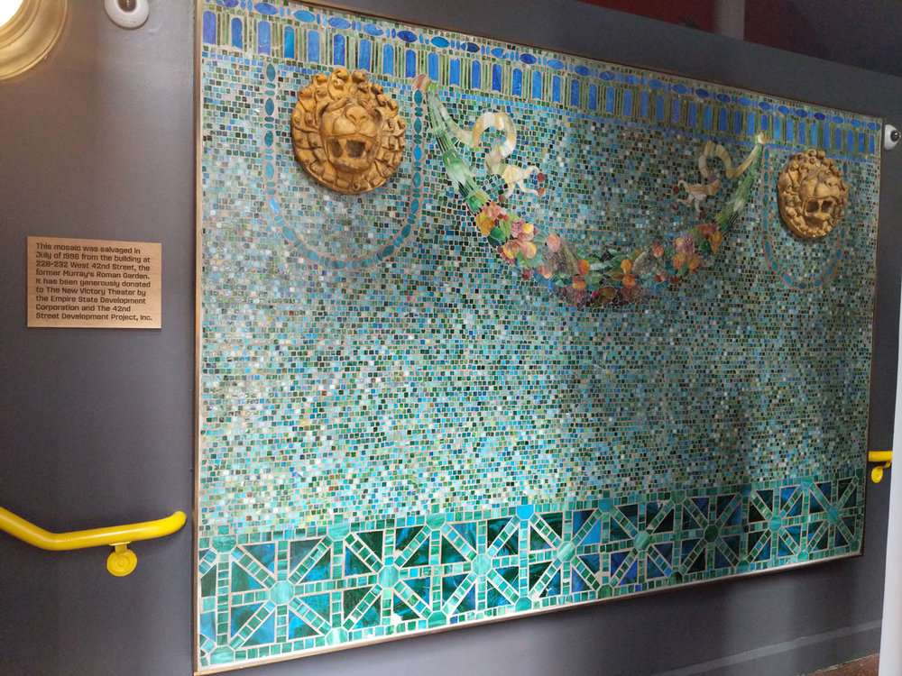 A glass mosaic from Murray's Roman Garden, now in the entryway of the New Victory Theater. Credit: New Victory Theater