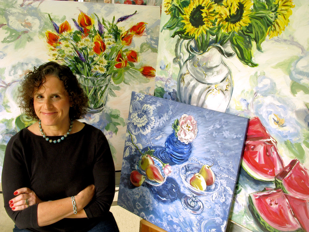 """2010 - Smilow Cancer Center, Yale-New Haven purchases three of Leona's still life paintings for their """"evidence-based"""" Art Collection. This is the third largest collection of original art in the state of Connecticut.Leona with the three paintings acquired by Smilow Cancer Hospital"""