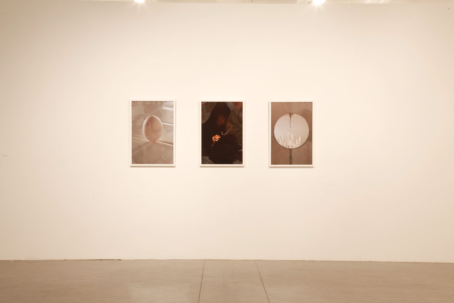 Installation view of Index (An Egg on its End, Diamonds and Pearls, Chandelier)