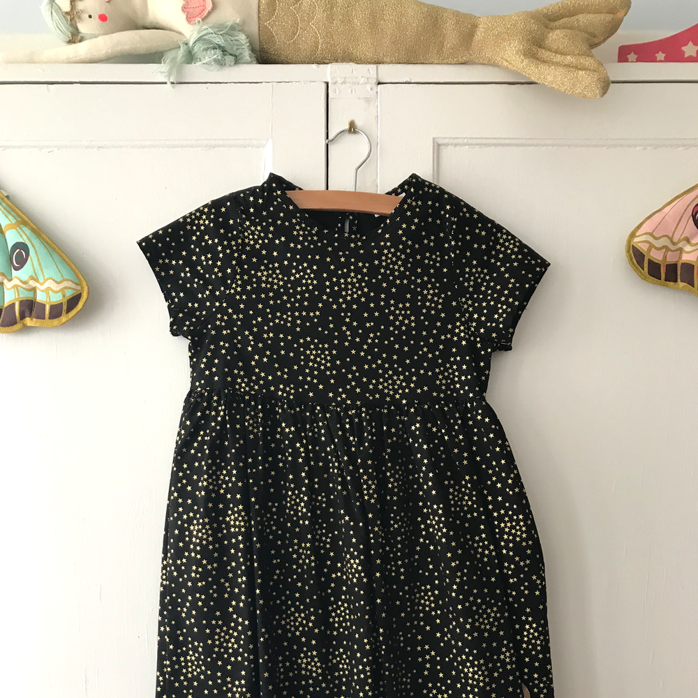 "A star is born - The Sunday dress from Smiling Button is the perfect party dress for your little one…and it's made right here in New England. There's also the ""Letter from Santa Kit"" for $30. Post your letter by December 15th and Mr. Claus himself will respond! Available at Bluebird Day Kids, 149 Water Street."