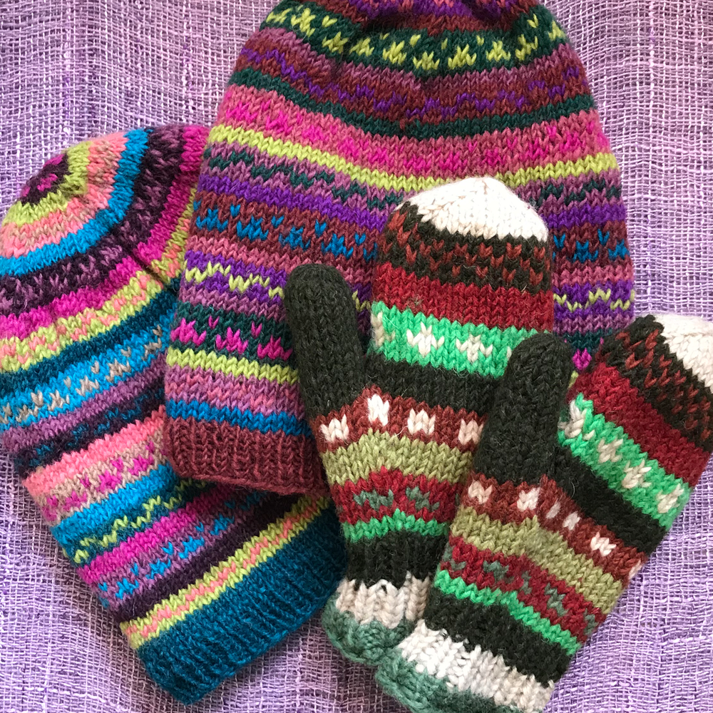 Warm and fuzzy - The Hungry Palette has a fun selection of wool-fleece hats and mittens, hand-knitted in Nepal. They're also fair trade. $23.50 for hats, $19.50 for mittens. 105 Water Street.