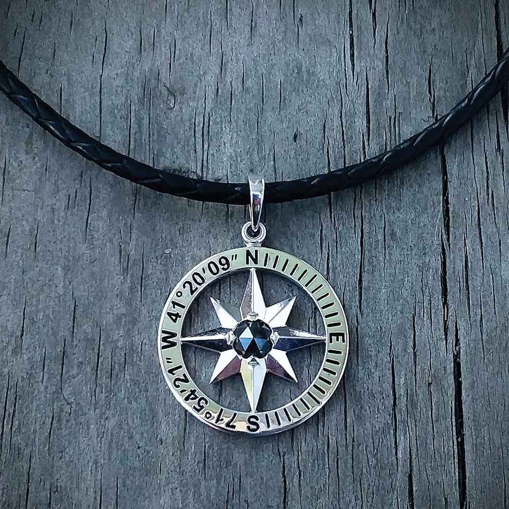 Fine jewelry with a coastal flair - The Compass Rose Collection pendant, available in sterling silver or 14K with longitude and latitude of Stonington. Shown with rose cut black diamond, starting at $160.Maggie Lee Designs, 135 Water Street, back porch entrance.