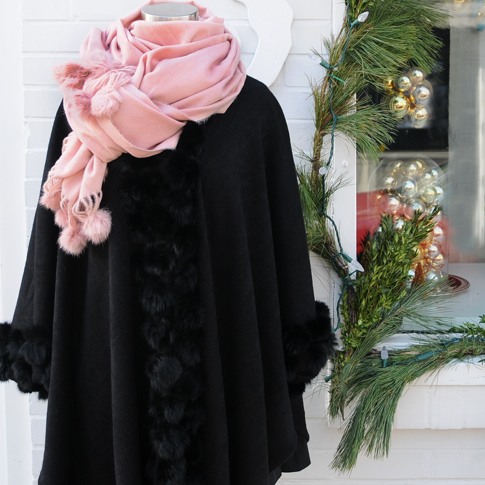 Pom poms and cashmere - Girly girls love soft, furry things and Tucci Design has the prettiest cashmere blend and faux fur pom pom scarves and ponchos that are soft AND furry! There a number of colors to choose from and they're all so gorgeous it's hard to decide. 120 Water Street.
