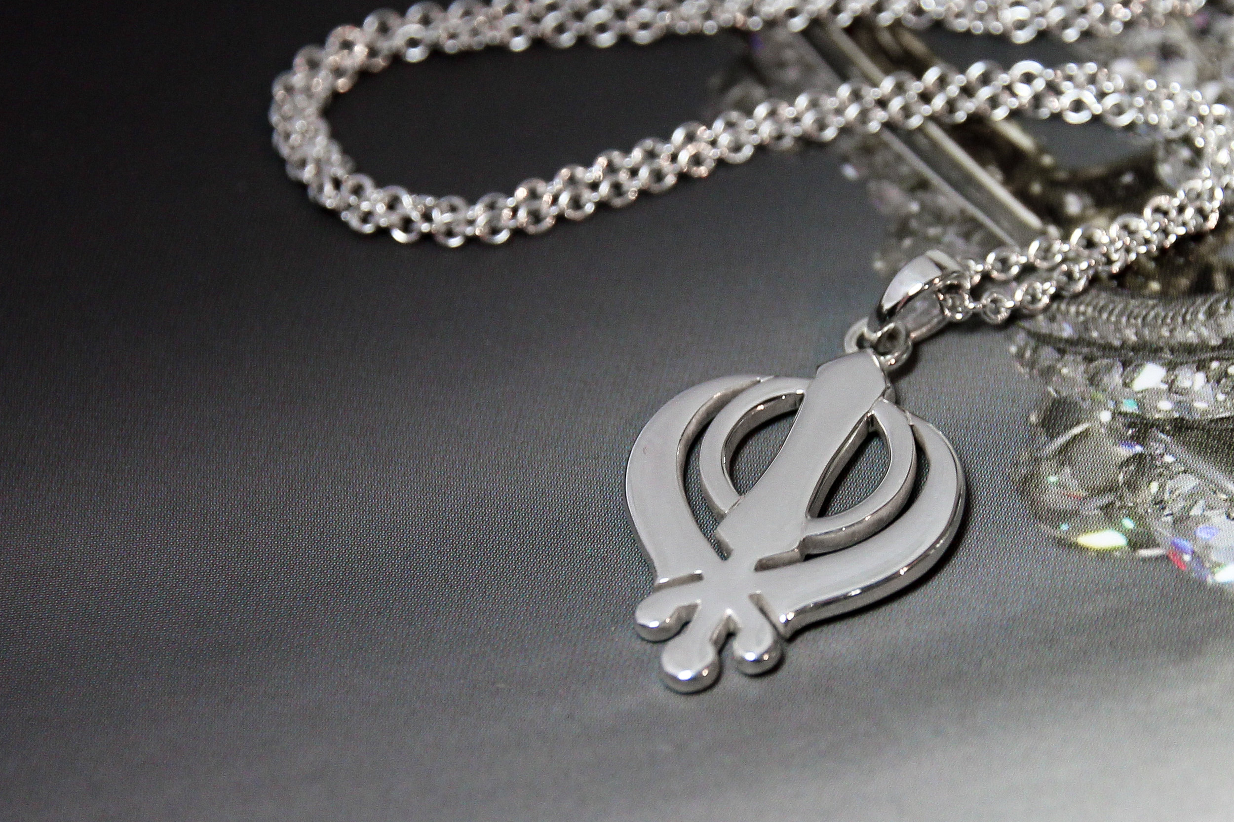 Small sterling silver khanda pendant necklace