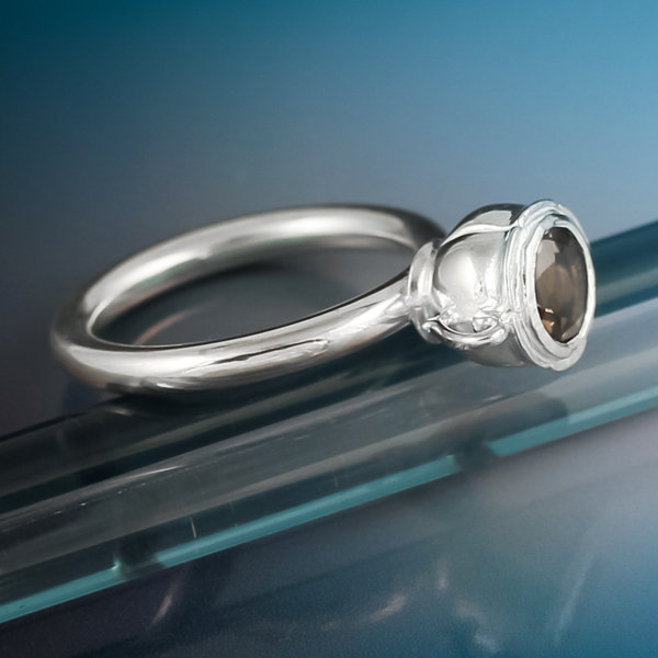 Silver tea cup ring