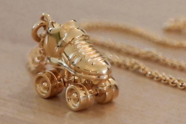 Gold plated roller skate necklace