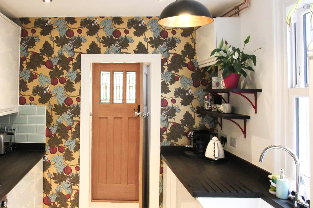 Fornasetti-frutto-proibito-wallpaper-in-kitchen-renovation