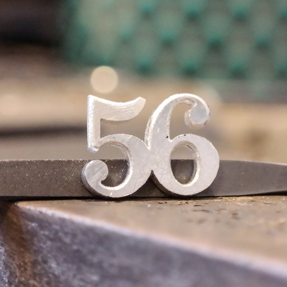 Sterling silver hand made number charm work in progress