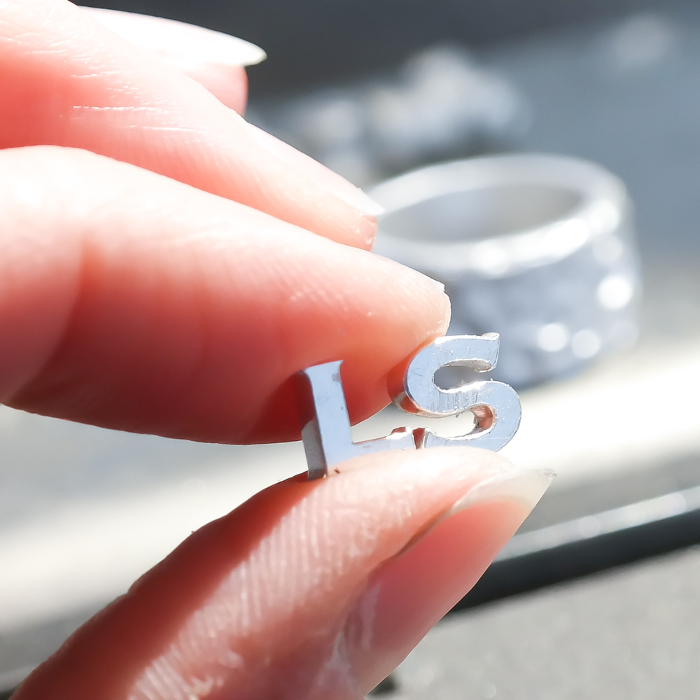 Sterling silver handmade mini initial charms designed in London