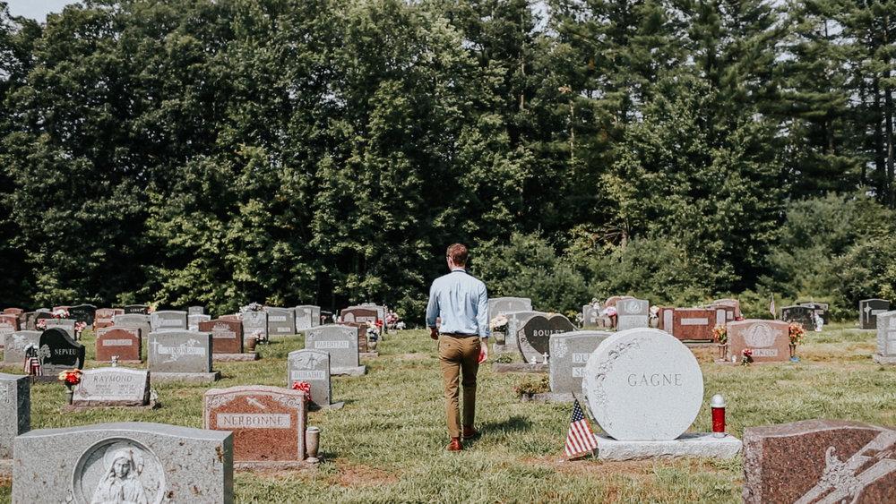 Jason Moon walks through the Saint John Baptiste cemetery.
